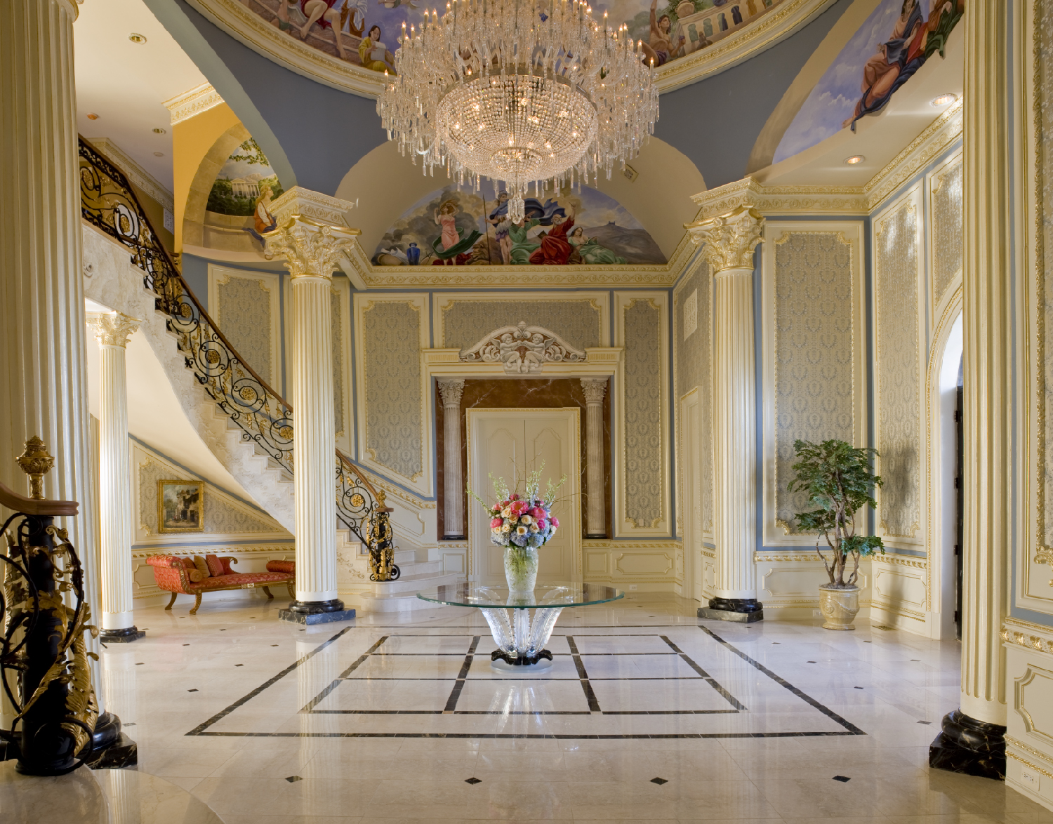 Luxurious Foyer with Lalique table and flowers