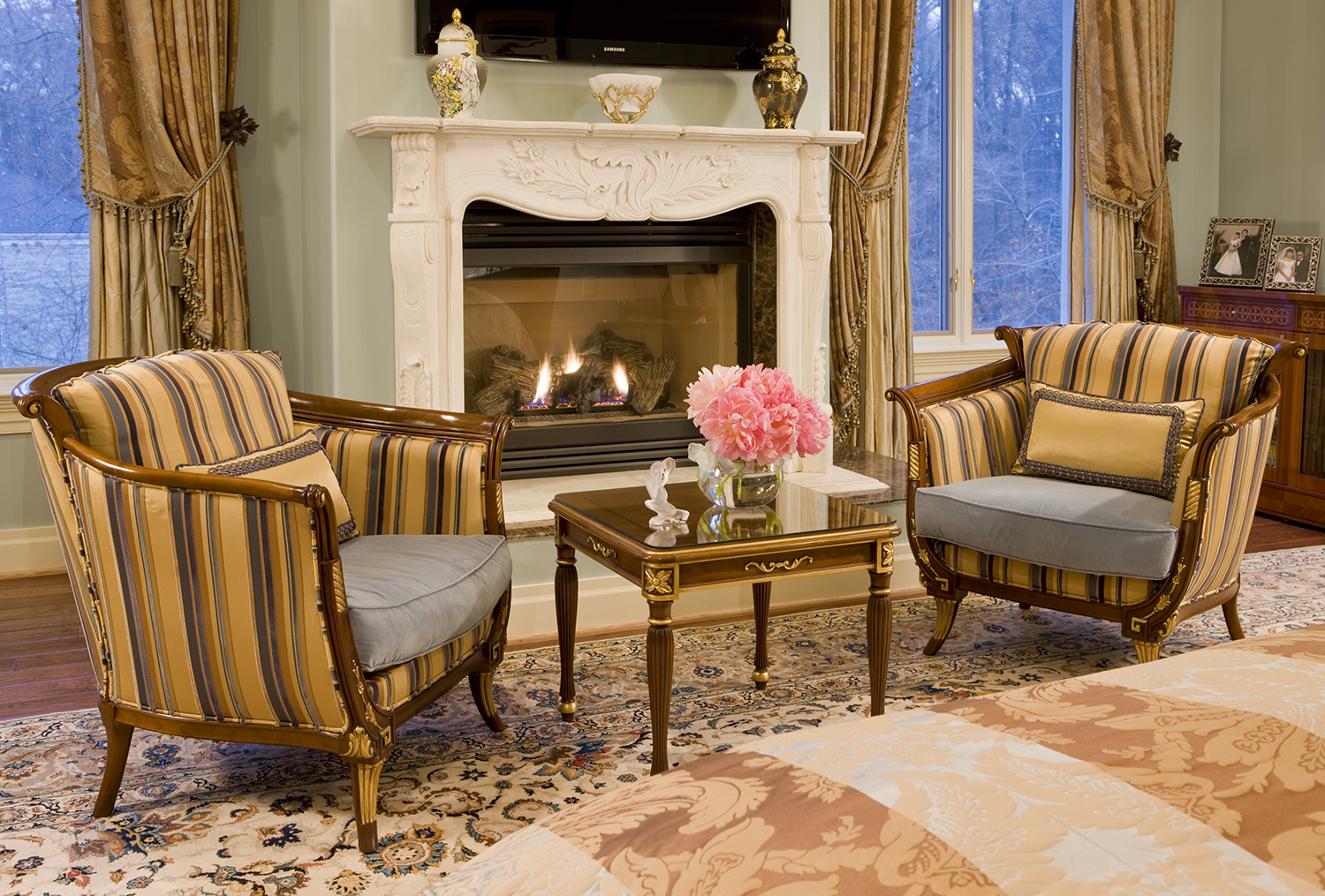 Two chairs in front of a fireplace