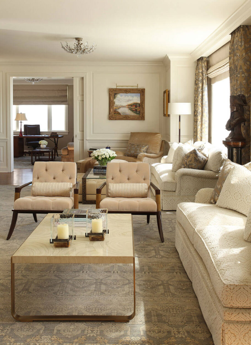 Living Room and home office with neutral color sofa, chairs with tan drapes.