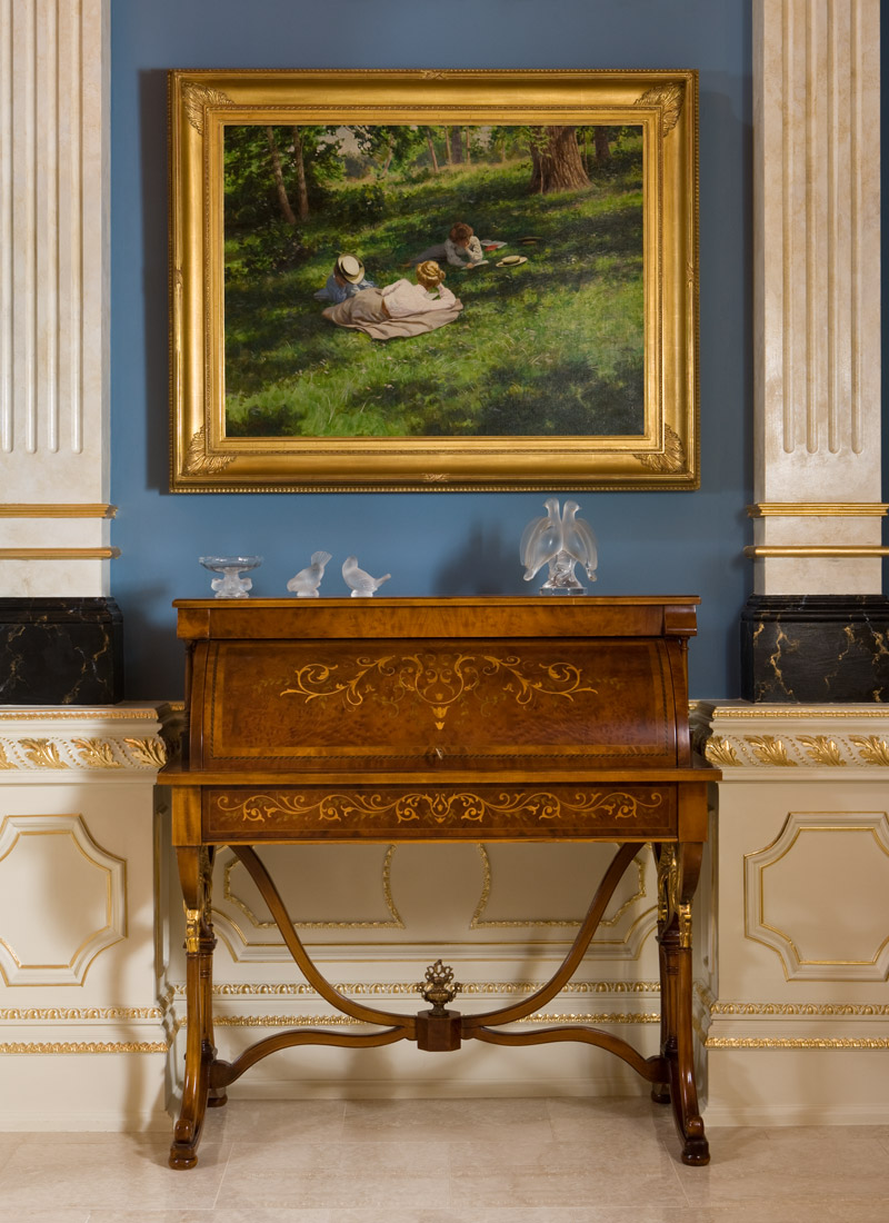 Blue wall and wood antique table with painting