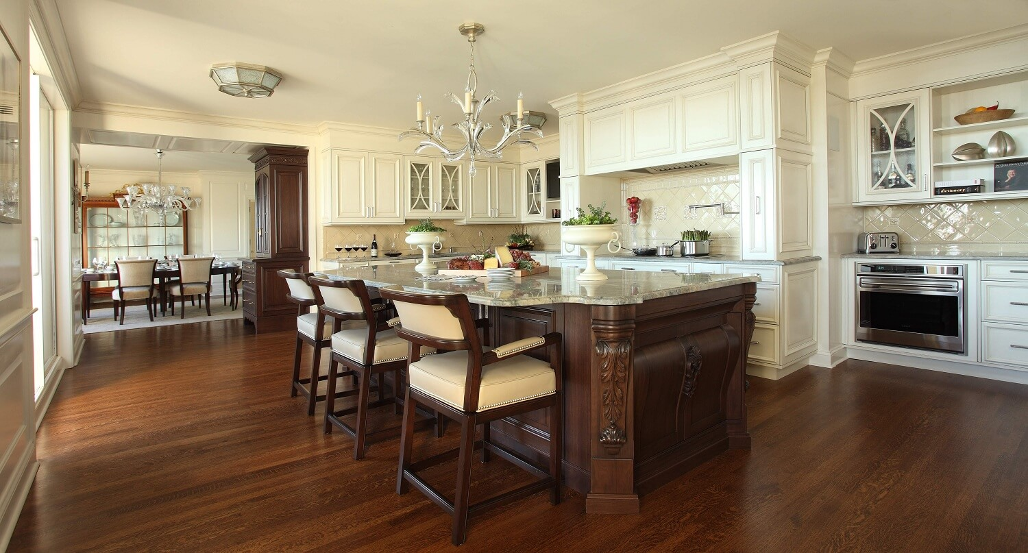 Gorgeous kitchen design with beige, wood cabinetry in a Four Seasons Penthouse.