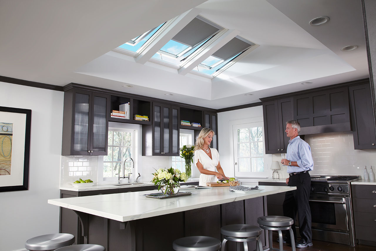 Woman and Man in their kitchen with natural light Sun Tunnels by Velux