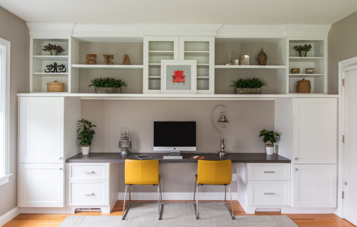Home office built-in cabinets with two chairs